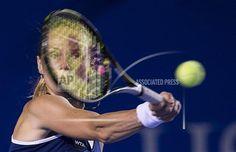 Magdalena Rybarikova of Slovakia returns the ball to Maria Sharapova of Russia during a Mexican Tennis Open during a quarterfinal match in Acapulco, Mexico, Thursday, Feb. 26, 2015. (AP Photo/Christian Palma)