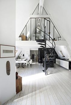 An white attic conversion with industrial details in Paris