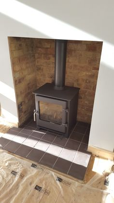 Town and Country Saltburn stove, quarry tile hearth Wood Burner Fireplace, Fireplace Hearth, Quarry Tiles, Log Burner, Front Rooms, Fire Places, Town And Country, Stoves, Wood Burning