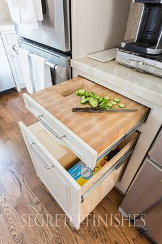Pull out drawer cutting board with hole for trash down below. In my next house!  Segreto Secrets