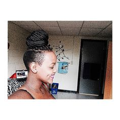 Box braids and a shaved sides