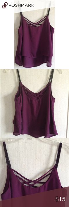 Charlotte Russe Caged Back Beaded Top Excellent condition. A few loose threads that seem to be where the beads are secured. Super cute Charlotte Russe tank top. Purple chiffon fabric with two layers. Cool criss cross cage on the back. Small black beaded straps. Scoop neck. Darted front for a nice fit. Size medium. Charlotte Russe Tops Tank Tops