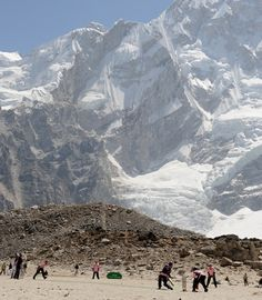 Two teams of British cricketers took part in the world's highest match ... on the side of Mount Everest.  50 cricket-mad explorers spent nine days trekking through the Himalayas to Everest Base Camp at a plateau of 5,165m.  Once on the frozen lake bed they got out their cricket gear and were very happy.  They played a full match setting a new world record for the highest altitude ever recorded for a field sport ... not that it is an overly contested title.