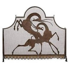 Art Deco 1930s fire screen with stylized leaping gazelles.