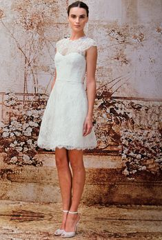 Brides.com: Monique Lhuillier Short Simple Sleeveless Lace  A-Line Wedding Dress from Fall 2014 Collection | Click to see more from this collection!