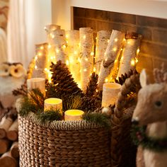 Accent a basket of fireplace logs with pinecones and garlands, then make it glow with battery-operated Amber Glimmer Strings™. Find more bright ideas for Glimmer Strings™ here: http://on.pier1.com/1wCs1P3