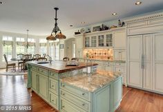 Beautiful kitchen with glazed cabinets