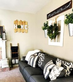 You have to see this #farmhouse living room decor idea with farmhouse wall signs. Love it! #RusticDecor #HomeDecorIdeas @istandarddesign