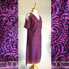 This beautiful pink and navy kaftan dress is made in Cape Town from sari fabric. It was designed to make women feel comfortable while looking elegant. It is a fitted dress that is easy and light having a v-neck design that is perfect for the bust and an additional design of two side slits and a cold shoulder.