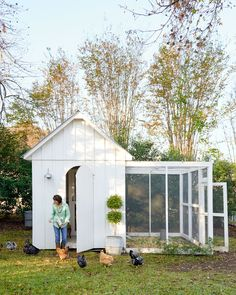 Christi utilized the same style-for-a-steal strategies in the backyard chicken coop. A farmhouse sconce outside plus a thrift-store armchair and antique oil painting inside take it from hardworking to good-looking. - CountryLiving.com