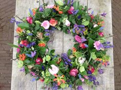 Delicate small flowers adorn this beautiful wreath., Delicate small flowers adorn this beautiful wreath. Funeral Floral Arrangements, Flower Arrangements, Summer Door Wreaths, Christmas Wreaths, Pretty Flowers, Small Flowers, Grave Decorations, Memorial Flowers, Sympathy Flowers