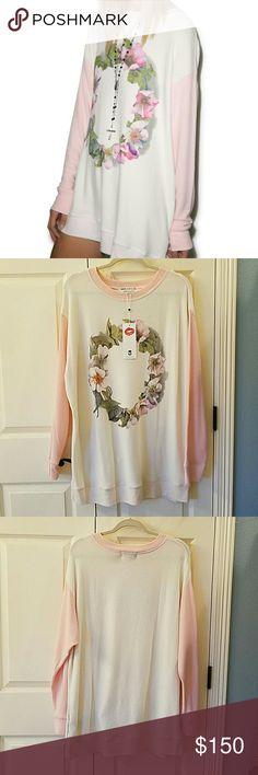 Wildfox Flower Wreath Roadtrip Sweater NWT Super cute and comfy roadtrip sweater.  Oversized and longer than baggy beach jumper.  Not worn.  No flaws. Wildfox Tops Sweatshirts & Hoodies