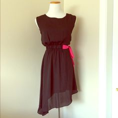"""🚩SALE🚩NWT ASYMMETRICAL HEM DRESS Darkest of blue - almost black in color with a pretty bright pink attached sash belt detail on the side. Lined. Beautiful dress! Fabric is 100% Polyester. Approx measurements: chest 16"""", waist 12"""" (garterized), length shortest 31"""" longest 39"""". Dresses"""