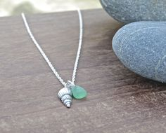 This beautiful and delicate fine silver shell has been handmade by me in my workshop in Cornwall using silver metal clay, and would make an interesting and natural looking addition to any outfit. I have added a beach-glass charm to the necklace, using glass found on Cornish beaches which I have hand drilled. With the shell available in a choice of finishes (oxidised or natural shiny silver), you can be sure you are getting a unique piece of jewellery reminiscent of the beaches of Cornwall.