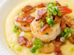 his super simple three cheese slow cooker shrimp and grits is not only incredibly easy, but it's also a lightened up version so you don't feel guilty! Easy Shrimp And Grits, Shrimp Grits, Southern Dishes, Southern Recipes, Southern Food, Slow Cooking, Slow Cooker Recipes, Crockpot Recipes, Easy Recipes