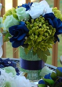 Beautiful colors and flower combinations. I love the sparkle on the vase and the blue ribbon tying everything together.