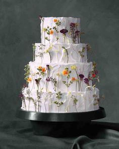 6 Fresh Ways to Decorate Wedding Cakes With Flowers | Martha Stewart Weddings - Edible flowers, from $9.50, gourmetsweetbotanicals.com #floralweddingcakes