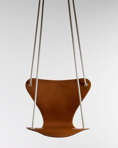 On of a kind Arne Jacobsen´s the Series 7swing seat with leather, a collaboration between Fritz Hansen & Louis Vuitton, 2005. Original design created 1955. / D Pages