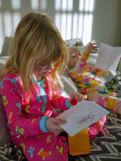 Little Hiccups: Reading letters from Santa on Christmas morning. Santa's stationery from http://www.etsy.com/shop/ParrottDesignStudio