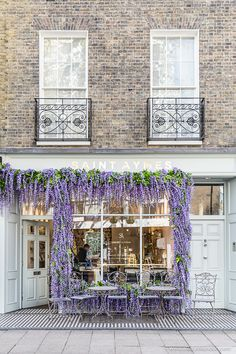 The pretty wisteria covered facade of Saint Aymes cafe in London's Connaught Village is one of the most beloved in London. #wisteria #facade #cafe #london