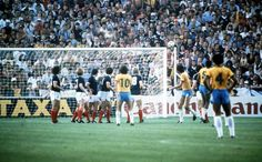 World Cup Finals, Seville, Spain, 18th June, 1982, Brazil 4 v Scotland 1, Brazil's Zico (10) bends the ball around the Scottish wall to score their first goal from a free kick