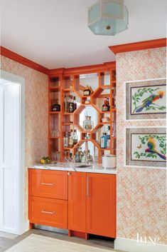 "Custom wet bar, painted ""Orange Parrot"" by Benjamin Moore. Wallpaper is ""Pena Palace"" by Philip Jeffries, flush mount is from Coleen and Company. Artwork is vintage Hermes scarves Home Wet Bar, Bars For Home, Decor Interior Design, Interior Decorating, Palm Beach Decor, Pena Palace, 1960s House, Built In Bar, Orange Interior"