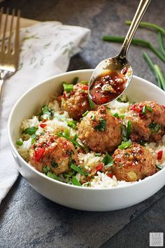 Asian Pork Meatballs over Coconut Rice is an easy recipe to make any night of the week. The secret to this recipe is the amazing Asian inspired sauce! It is a snap to throw together using a coconut balsamic reduction, and I can't get enough of the sweet, Easy Dinner Recipes, Easy Meals, Easy Recipes, Oven Recipes, Rice Recipes, Asian Pork, Asian Rice, Coconut Rice, Cooking Recipes