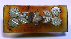 "7/8"" Silver Flower Inlay on Translucent Horn Antique Button."