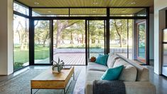 photography by Leonid Furmansky Architectural Photography Photo 9 of 16 in Lake Austin Cabin. Browse inspirational photos of modern homes. From midcentury modern to prefab housing and renovations, these stylish spaces suit every taste. Live Oak Trees, Prefab Homes, Modern Exterior, Glass House, Sustainable Design, Building Design, House Plans, House Design, Cabin