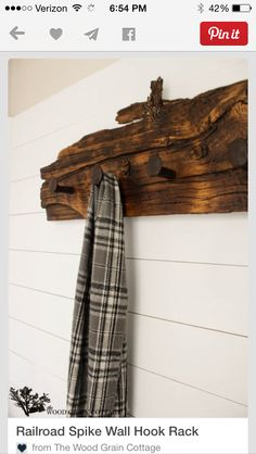 I need some sort of coat rack. just an idea, not big on this exact design. Railroad Spike Hook Rack by The Wood Grain Cottage