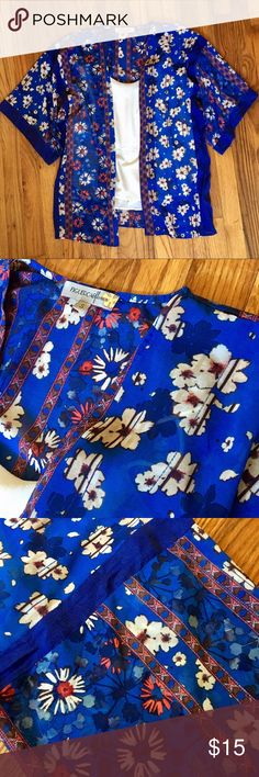 Floral Kimono Floral Kimono. Blue with cream and orange/red flowers. Falls mid-butt (I'm 5'9). Light, airy feel. Loose Fitting. Can fit a size Small or Medium. White shirt not included. Gently worn. Figueroa & Flower Tops