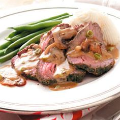 """Mushroom-Blue Cheese Tenderloin Recipe -""""This is a simple recipe that tastes fabulous. I usually double the mushroom-Roquefort sauce, because it always disappears very fast. Enjoy the tenderloin!"""" —Eric Schoen, Lincoln, Nebraska"""
