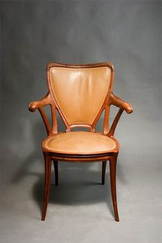 Eugéne Gaillard (1862-1933) - Arm Chair. Carved Cherry with leather Seat and Back. Circa 1905. 93cm.