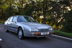 Citroen CX GTi Turbo 2 being driven (quite spiritedly!) along the road home from the Citroen Car Club's CX, XM and Xantia Rally.    Can't beat a CX GTi Turbo 2!!    Shot with a Nikon D90 and Nikon 18-105mm Lens.     how to (buy|sell|import|export) (cars|engines|turbos|turbochargers)