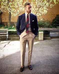 Mr. Andreas Weinås Navy jacket. Chinos. White button down shirt. White tv fold pocketsquare. Navy/red block stripe woven tie. Brown tassel loafer shoes.