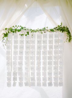 Wedding escort card display: Venue: Boyne Mountain - http://www.stylemepretty.com/portfolio/boyne-mountain Photography: Rebecca Yale Photography - rebeccayalephotography.com   Read More on SMP: http://www.stylemepretty.com/2017/03/29/michigan-summer-lake-wedding/