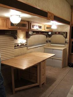 Unfortunately not many RV's are setup with a RV office area to serve those needs. A great example of turning a dinette into a functional RV office areas.