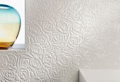 These swirling roses add some cheeky romance to this wall. This ceramic tile is surprisingly easy to keep clean with it's glossy surface and gentle curves. 3d Tiles, Ceramic Wall Tiles, House Tiles, Tiles Texture, Contemporary Fashion, Design Consultant, Store Design, Grey And White, Sweet Home