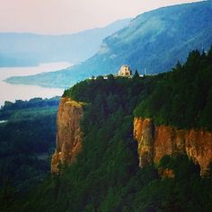 View of Vista House at Crown Point along the Columbia River Gorge from Chanticleer Point, Oregon.