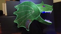Dragon Headdress With EL Wire: This is an Instructable about how to make a dragon headdress out of sheets of foam (sparkly and normal), fishing wire, and strand lights/EL wire (optional). The total cost of making this headdress is about of sparkly foam, Make A Dragon, Dragon Pictures, Headdress, Dinosaur Stuffed Animal, Wire, Inspiration, Biblical Inspiration, Fascinators, Headpiece