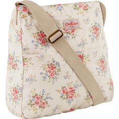 Our popular cotton messenger bag is a relaxed style that looks great worn across the body. This design features our pretty Pinny Flowers print, with contrasting lining and fully adjustable webbing strap There are also some handy pockets, perfect for your phone or purse - two on the inside and two on the outside!