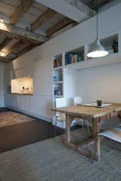 Love this rustic/raw looking table with the ultra white, clean line of the kitchen.