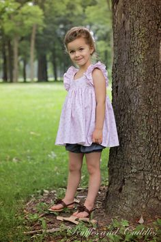 Pink and Chambray Flutter Sleeve Top with Bloomers for Girls. PDF pattern by Violette Field Threads, made in USA by Ruffles and Cuddles https://www.facebook.com/RufflesandCuddles/photos/ms.c.eJw9ytENACAIA9GNDFALdP~;FNGr8u5ccDV6dpkYoavCYDc~_MxPPOKVHxfX8um3sM4w~-~-.bps./503178626499592/?type=1&theater