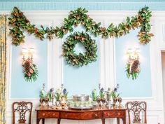 The dining room in Lilly House at the Indianapolis Museum of Art is decorated for Christmas with magnolia leaves and palmetto fronds. The la...