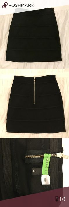 H&M Black Banded Mini Skirt Super cute black mini skirt! Silver zip up back. In great condition. H&M Skirts Mini