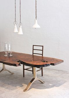 the obsession with slab furniture continues into the dining room. BDDW with brass legs.