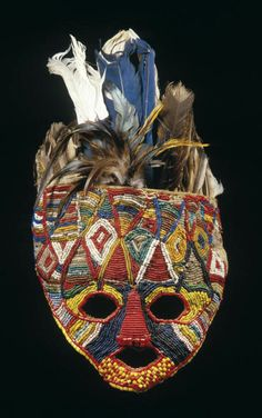 Africa | Face mask from the Tabwa people of DR Congo || Beaded masks surmounted with a variety of colored feathers were used in the Bulumbu possession cult of the Tabwa.