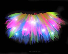 ITEM IS HAND MADE TO ORDER. PROCESSING TIME IS 2-3 WEEKS AND 7 DAYS SHIPPING Tutu Factory Cascade style tutu made of SIX layers - made of neon pink, green and blue with white LED lights. Thats right, this tutu lights up! Tutu has one battery pack attached to the back that requires 3xAA batteries (batteries not included) PHOTOS OF TUTUS ARE TAKEN IN THE DARK SO LIGHTS WILL BE MORE SUBTLE IN DAYLIGHT. Fits a UK 8 - 14 US 6 - 12 Elasticated waist so super stretchy. Other sizes, colours and…