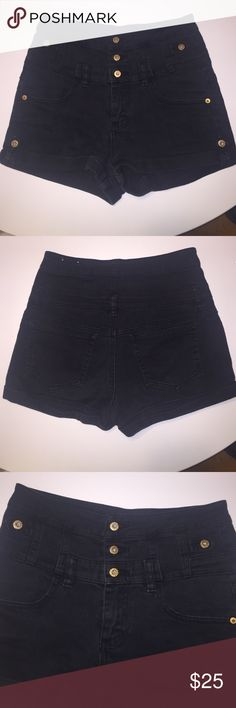 High wasted topshop black shorts High wasted topshop black shorts with three buttons and zipper. Size 28w in topshop fits a us size 4 Topshop Shorts Jean Shorts