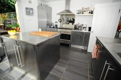 NOW I see how great those type of tiles can be!!!!! Next floor for me for sure!!!   contemporary kitchen by Beccy Smart Photography
